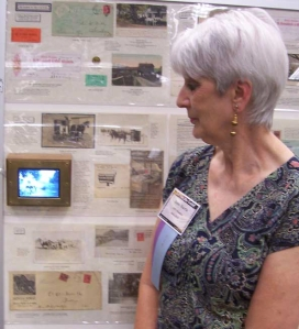 Anne Harris viewing her exhibit video tape
